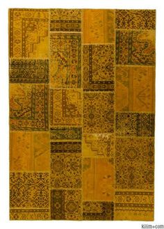 Over-dyed Turkish patchwork rug created by first neutralizing the colors and then over-dying to yellow to achieve a contemporary effect and bring old hand-made rugs back to life. This piece is backed with cotton cloth as reinforcement.