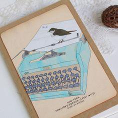 turquoise typewriter on moleskin