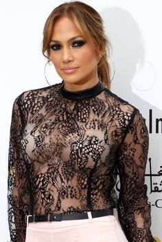 Jennifer Lopez is proud of her body and she's not afraid to show it! The singer and actress arrived for a press conference in Morocco donning a super sheer lace top that exposed her bra on May 28, 2015.