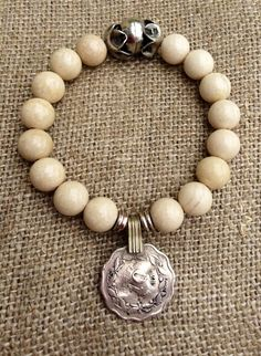 White fossil stretch bracelet with rustic by CountryChicCharms, $38.00