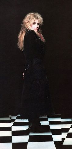 a stunning photo of Stevie in black standing on black and white tiles   ~ ☆♥❤♥☆ ~    photo by Herbert W. Worthington 111; these tiles were part of his photography studio