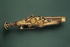 Not Steampunk, but definitely steampunkish. Probably more clockpunk than anything. Double-Barreled Wheellock Pistol of Emperor Charles V, 1540 - 1545