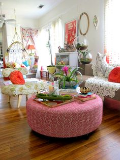 This is a fun table/ottoman for this space. Love the bromeliad in the middle.