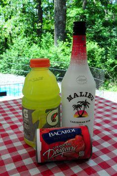 Liquid Skittles Mixed Drink  6 oz. Malibu Mango Rum  12 oz. Strawberry Daiquiri Frozen Mix  6 oz. Gatorade Lemon-Lime. Yum!