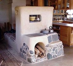 Thermal mass combined with wood stove cooking