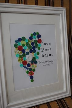 Love board...good idea for baby shower. Ask everyone to bring a button and glue it. Good alternative to the thumb print art.