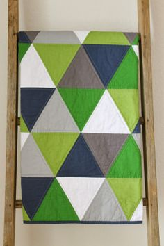 craftyblossom: navy and green equilateral triangle quilt.