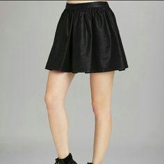 BCBGeneration black denim skirt Denim skirt with a little bit of a sheen to it.....hidden zipper inthe back....cotton cotton/polyester blend.......tuNWT BCBGeneration Skirts Mini