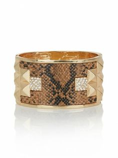 Snake Cuff    This brown and gold snake cuff makes a bold statement that will accent any outfit beautifully.