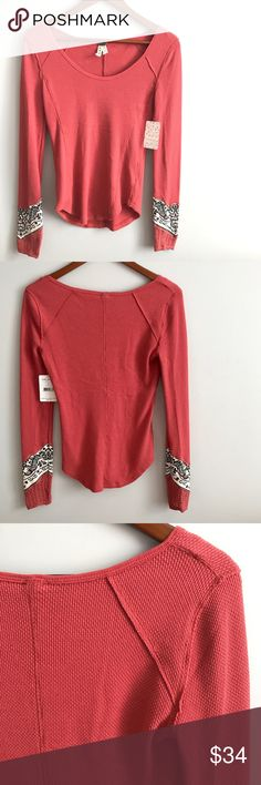 Free People Long Sleeve Top Free People Top - NWT  - Size medium  - Rust/coral color  - Long sleeves  - Lace/ pattern detail at the ends of sleeves - Waffle Knit type material Free People Tops
