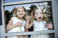 two girls pressed to window at wedding, photo by top Dallas wedding photographer Ashley Garmon | junebugweddings.com