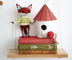 DIY nursery shelves - drill holes into wood planks. Thread rope through and knot the ends. The perfect place to hang rustic accessories in this woodland-themed nursery.