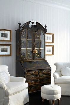 Antique cupboard, juxtaposition of dark and light. Love the black paint with bronzy hold trim on the windows