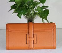 Hermes Clutch Bags 509058 Orange  $168.00    Quality: Grade A+++++(7 Stars), Super Replica bags made of 100% Genuine Leather.  It looks and feels the same with the originals.  Few people can recognize it is not an original bag.  What you can receive is just the same with the pictures here you see.  It Comes with serial numbers, authenticity card, dust bag and care booklet.
