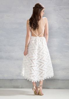 Take this white maxi dress out for artisanal cocktails and you'll understand your reason for existence! Flaunt the embroidered zigzagging - fit together with triangular cutouts - that extends from its tapered shoulders to its intricately crocheted hemline, then spin to show off the open back of this beige-lined number so the whole neighborhood can gawk at its gorgeousness.
