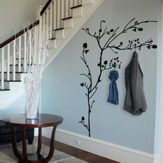 Interior designed hallway idea for storing coats using tree decals, brilliant. Pale duck egg blue scheme.                                                                                                                                                      More