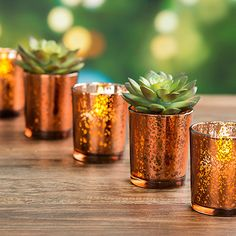 Find rustic glam wedding decorations like this beautiful David Tutera™ copper mercury glass votive cup. These charming spotted copper votive candle holders will give your bohemian reception a romantic
