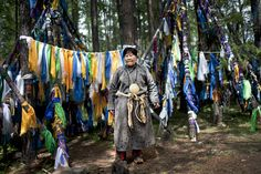 Eurasian Shaman with Spirit Trees covered with offerings.