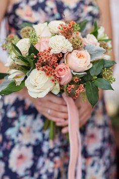 Falling for You bridal bouquet. Flowers in this kit are: roses, garden roses, wax flower, alstroemeria, scabiosa pods, wood flowers, eucalyptus, camellia and dusty miller greenery.