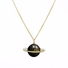 Saturn is one of Après ski's most recognisable accessories inspired by the cosmos. A simple planet Saturn pendant hanging from a thin golden...