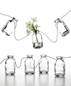 I really want these for the backyard $19 here  http://www1.macys.com/catalog/product/index.ognc?ID=513793&CategoryID=9545&LinkType=#fn=sp%3D3%26spc%3D2328 Bottle Vase, Glass Bottles, Glass Vase, Table Umbrella, White Christmas Lights, Night Time Wedding, Summer Wedding, Holding Flowers, Garland Wedding