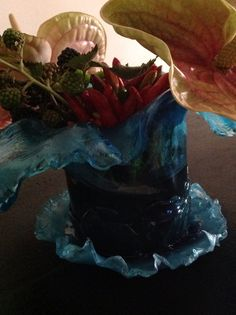 Blue waved resin vase completely hand worked by me.