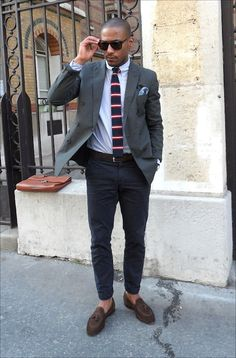 NY Street Style. This dude did a nice job pairing a striped knitted skinny tie with blazer, contrasting navy chinos, and casual pocket square. We also like the sockless look paired with tasseled loafers.