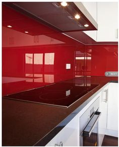glass splashback adds colour and easier to clean than tiles