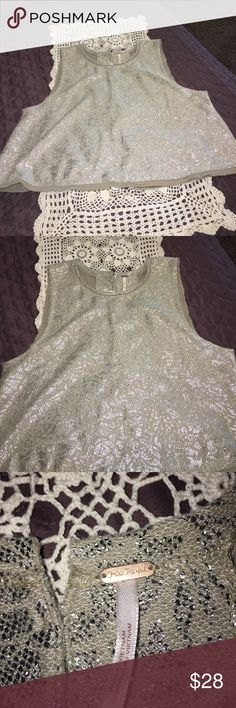 Fee People sleeveless top Gorgeous top, this blouse can be dress up or dress down, versatile, great for any occasion. Free People Tops