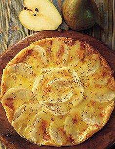 Recette tarte fine de poires au maroille et au cumin : Préchauffez le four à 180° (th. 6). Abaissez la pâte feuilletée sur une plaque à pâtisserie anti...