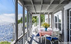 On a glorious summer day in Maine everyone wants to be outdoors, and a screened porch is a great place for a meal. Grand Resort's Anna Maria table and chairs from Sears are made of all-weather aluminum with a glossy white finish. Tablecloth from House of Logan.   - CountryLiving.com
