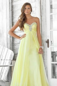 """Start out searching for your perfect long maxi strapless light yellow prom dress by flipping through magazines and online to see what kind of dress you are most attracted to. Then hit the stores with an idea in mind of what you are looking for. Try on as many dresses as you can; your idea of the """"perfect dress"""" may not be as well suited for you as another style. Don't limit yourself."""