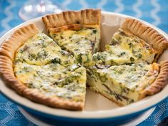 Perfect for a party or family get-together, Valerie's quiche is filled with mushrooms, hearty veggies (like broccoli and asparagus) and three types of cheese to maximize flavor.