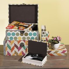 Book boxes are a great way to hide remote controls on your coffee table. Matching trunks can hold magazines or throws. Pictured: from O Magazine's Oprah's Favorite Things 2015 - Confetti Book Boxes by IMAX