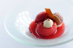 Peach melba with vanilla mousse, raspberry macaroon and raspberry sorbet