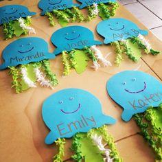 Jellyfish door decs! Card stock, glitter glue, googly eyes & yarn