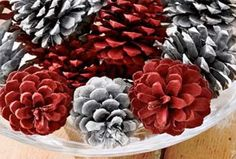 spray paint pine cones in red, silver metallic, and white and make into ornaments for your tree. simple and beautiful :)