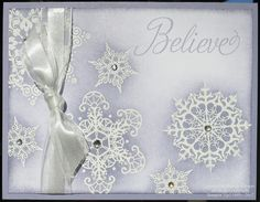"""The snowflakes from """"Snowflake Soiree"""" are stamped in Versamark on Whisper White cardstock and then embossed with White Embossing Powder  A sponge is used to add Wisteria Wonder ink across the embossed images."""