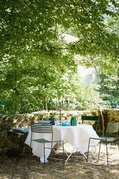 Garden Seating, vintage metal table, in the eighteenth-century French country home of textiles dealer Susan Deliss in garden room design ideas.
