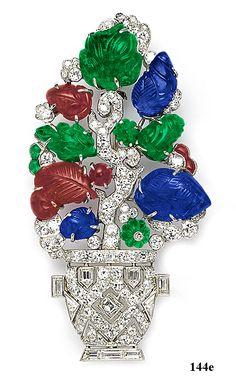 "Carved ruby, carved sapphire, carved emerald, bulletcut  diamond, square-cut diamond, baguette diamond,  triangle-cut diamond, diamond and platinum  ""fruit salad"" plant pot brooch. Mauboussin, Paris"