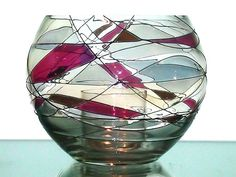 Partylite Mosaic Candle Holder P0193 Retired  Definitive two piece candle holder set from Partylite features hand blown and hand spun glass with stained sections that resemble shards of colored glass. Style name is Mosaic, Model P0193, retired by Partylite and only available now in the secondary market. Large holder, measuring 4 x 5 with a small interior cup to hold tealights or a small votive.