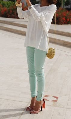 Mint skinnies + flowy top= a do for summer. To master the look, keep everything natural.
