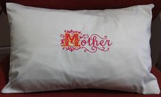 """Our Mothers day cushion is made of pale green sateen cotton, which has a shiny finish difficult to see in the photo. The letters are in deep rose with a gold outline on the """"M"""" to make it standout more, they are priced at £18 with £3 p&p... Thanks Anne x"""