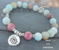 Amazonite, Rhodonite, yoga bracelet, Lotus, buddha, Ohm, om, mala beads  Gorgeous Genuine 8mm Frosted Amazonite and faceted Rhodonite, with your choice charm tone and design. Strung on a very strong elastic cord.  This design is © Copyright by Life Force Energy Shop® 2005-2013 Single Yoga Bracelets here: http://www.etsy.com/shop/LifeForceEnergy?section_id=10901055  More Yoga wrap Bracelets/Necklaces here http://www.etsy.com/shop/LifeForceEnergy?section_id=11305375  108 Malas Bracelet or…