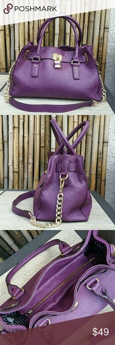 "Gorgeous Purple Satchel! Gorgeous Purple Satchel! Faux leather bag with removable long gold tone chain strap. Very clean inside and out. A few small flaws from wear shown in pictures. Zipper closure secure your belongings. Gorgeous color to brighten up any outfit!    Length 13"" Depth 9"" Width 5""  🚫No Trades 🙄😘  🔘Use OFFER button to negotiate👍🤑 🔘Please Ask ❓'s BEFORE you Buy🤔😃 💕Thank you for stopping by! Happy Poshing!💕 Bags Satchels"