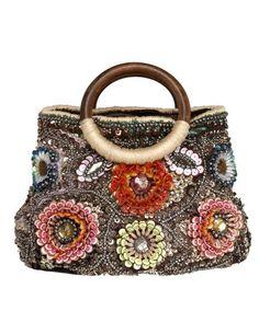 Mini bag ricamata con pailletes con motivo floreale.