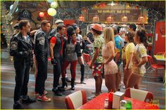 Teen Beach Movie big Momma's snack shack Big Momma's Big Menu in background - red, yellow & blue tables, red chairs. paper lanterns
