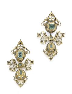 A pair of early 18th century Iberian emerald pendent earrings Each bombé surmount set with foiled, closed-back emeralds, suspending similarly-set bows and pear-shaped drops, composite, later fittings, length 5.6cm