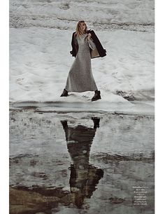 Emma Menteath poses in the snow wearing a shetland wool dress from Hermes with Stella McCartney coat and See by Chloe boots