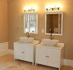 Semi-custom His and Her bathroom cabinets with designer bowl-shaped sink basins create a unique look in this master bath.